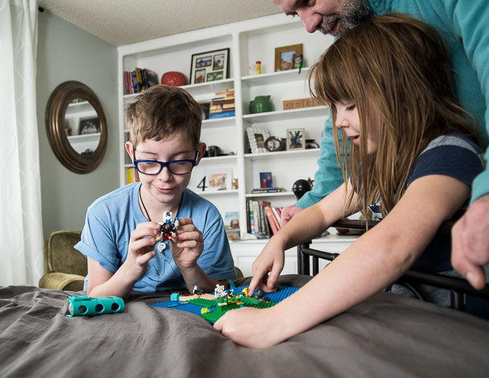 A boy and girl show off their lego creations in Denver. | Denver Family Photographer