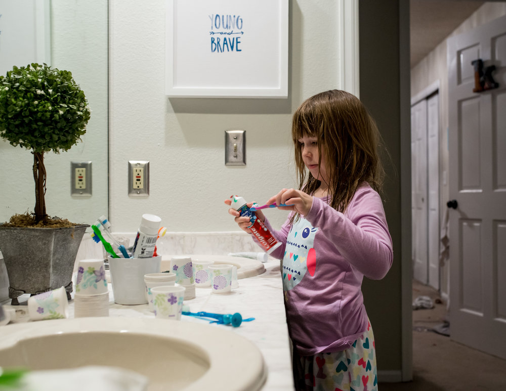 girl brushing teeth | Denver Documentary Photographer.jpg