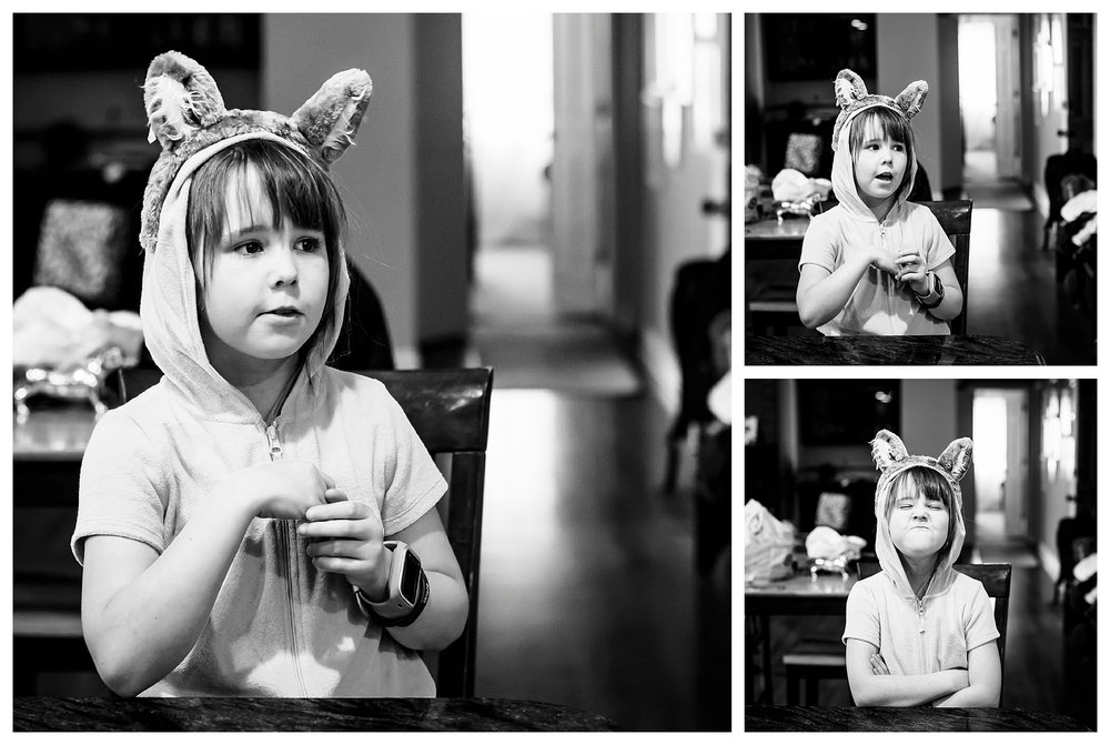 Denver candid family photographer with young girl in great wolf lodge cub ears talking.
