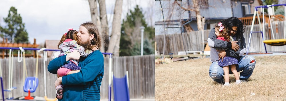 A mom and dad hugging daughter outside by swing set during a family photography session in Denver, CO. | Denver Family Photographer