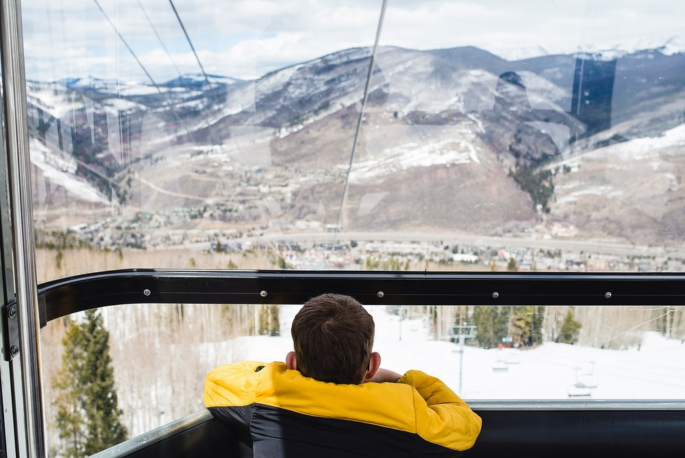 Boy riding the gondola on Vail mountain in Colorado | Denver Candid Family Photographer