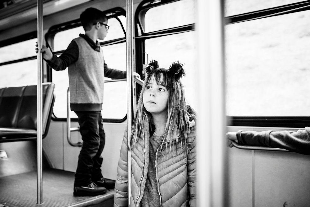 Black and white picture of Brother and Sister on the bus to Vail in Colorado | Denver Candid Family Photographer