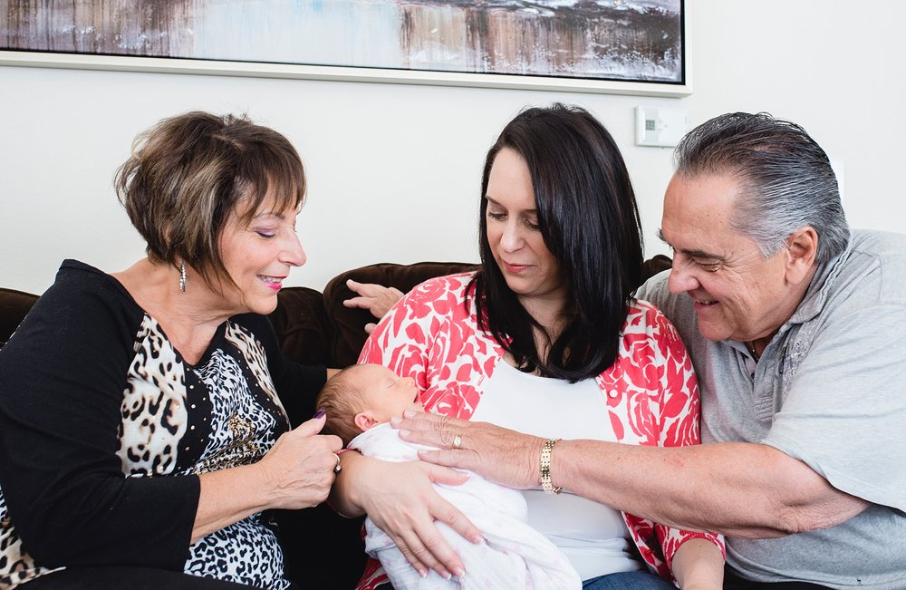 Grandparents meet their granddaughter in Denver, CO. | Candid Family Photography