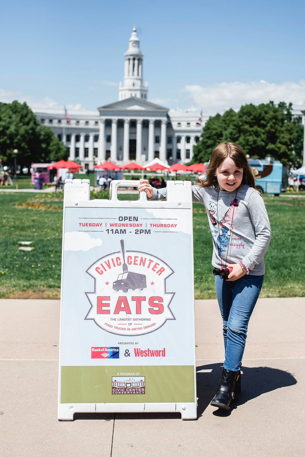A girl stands next to the sign for civic center eats in downtown denver, co. Denver Family Photographer | LIfestyle photography