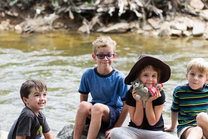 Kids sit by the creek in Estes Park, Colorado. Denver Family Photographer | Lifestyle photography