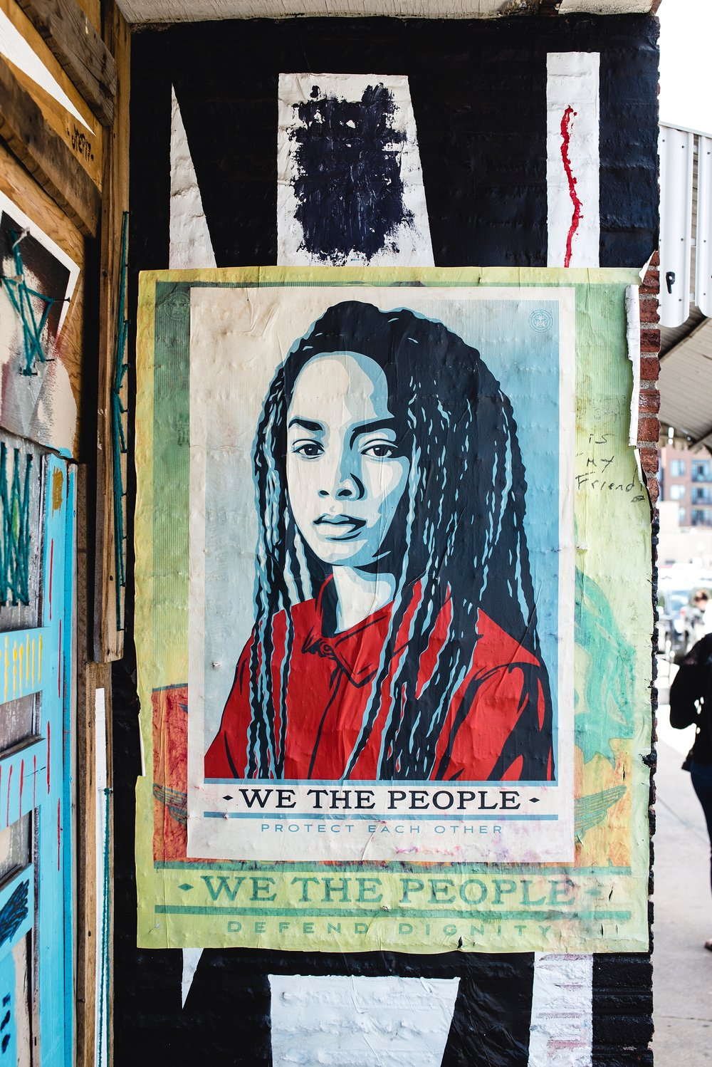 """We the people protect each other"" street art in RiNo, Denver, CO, is spotted on the NAPCP photo challenge walk."