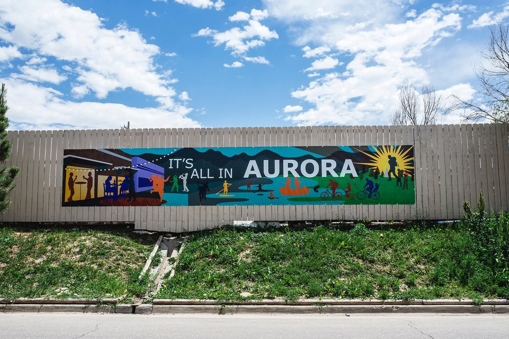 """It's all in Aurora"" is one of the many signs around the Stanley Marketplace forecasting big things to come for Aurora, CO. Photo by Kristiina Craven Photography"