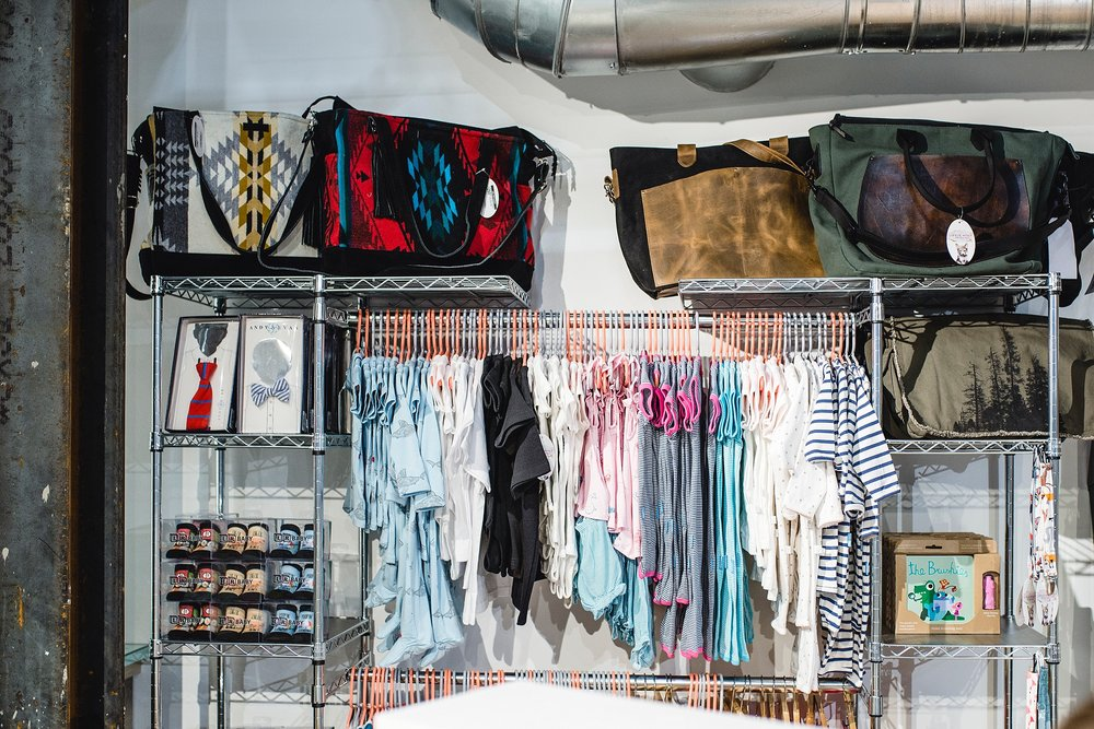 The Little Wolf boutique carries beautiful artisan gifts, clothes, diaper bags and more in their Stanley Marketplace location.  This is a great place for high-end baby shower gifting. Photo by kristiina craven photography.