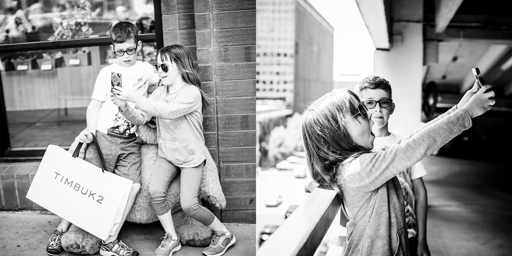 A sister uses an old iphone to take selfies of herself and her brother in downtown Denver's 16th Street Mall as shot by Kristiina Craven Photography.