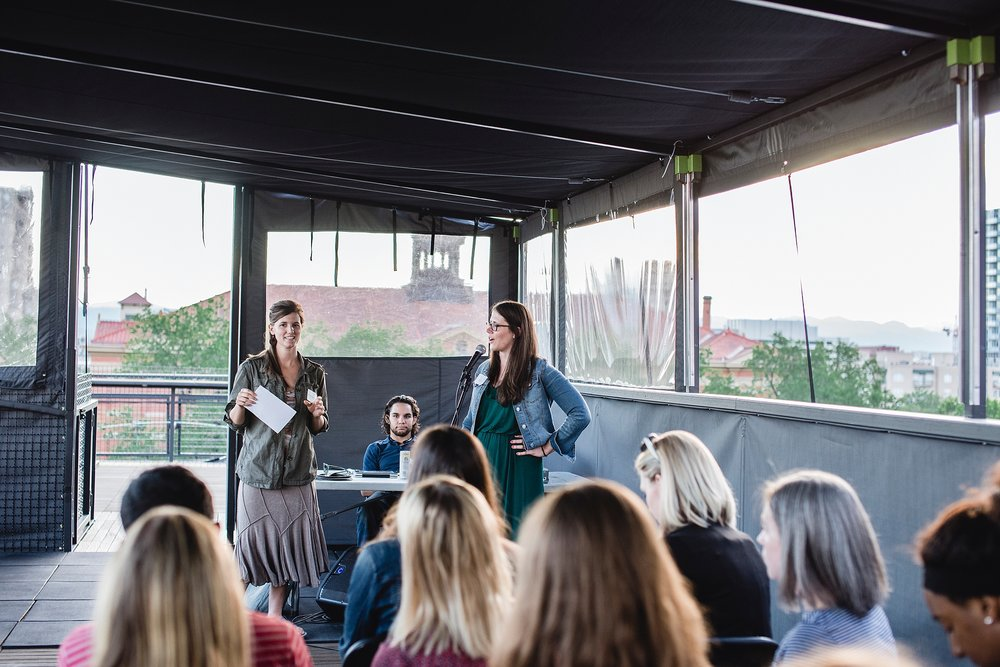 Rebecca Brinton introduces Alexandra Black Paulick to talk all things SEO at the Denver Rising Tide Society's Tuesdays Together on the rooftop space of the Broadway Metlo.  Photo by Kristiina Craven Photography