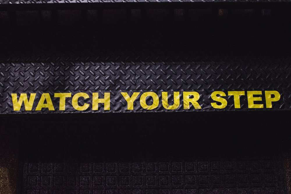 "A ""watch your step"" sign on your way up to the rooftop of The Metlo as shown by photographer, Kristiina Craven, in Denver, CO."