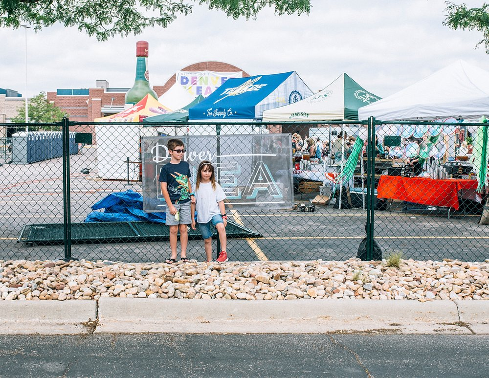 A view of the summer Denver Flea 2017 with two young kids by kristiina craven photography.