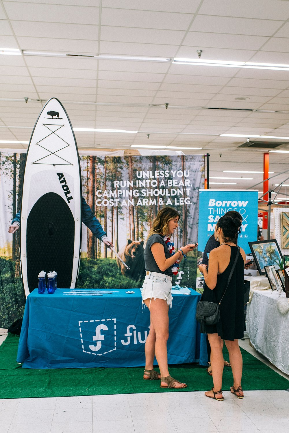 women discuss the Fluid Market app at the Denver Summer Flea 2017 by Kristiina Craven Photography.