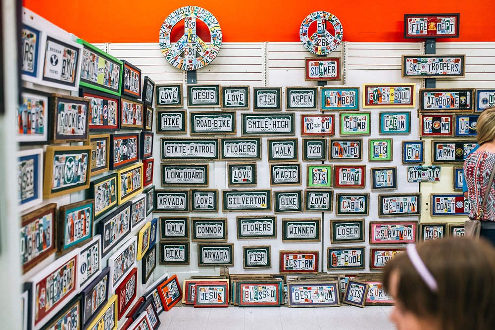Custom signs made from recycled license plates at the summer Denver Flea 2017 as photographed by Kristiina Craven Photography.