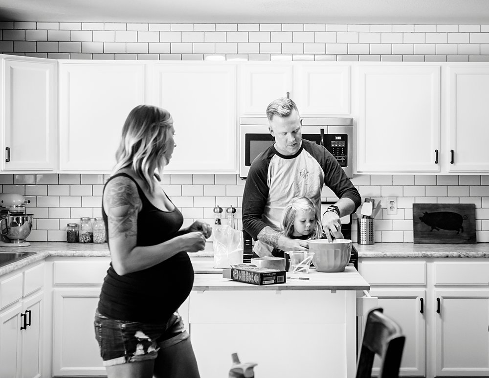 A young family makes pancakes before baby #2 arrives in Highlands Ranch, CO, during a maternity photo shoot by Kristiina Craven Photography.