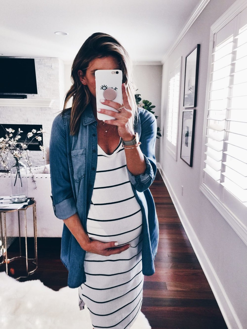A pregnant woman wears a black and white maternity dress and chambray denim shirt.  Cute and practical maternity outfit for Colorado weather on the Kristiina Craven Photography Blog. (Image from CellaJane.com)