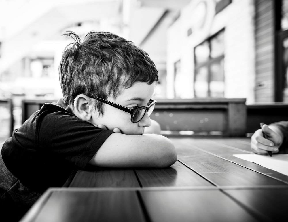 A boy patiently waits for his lunch at 5280 Burger Bar in Denver.