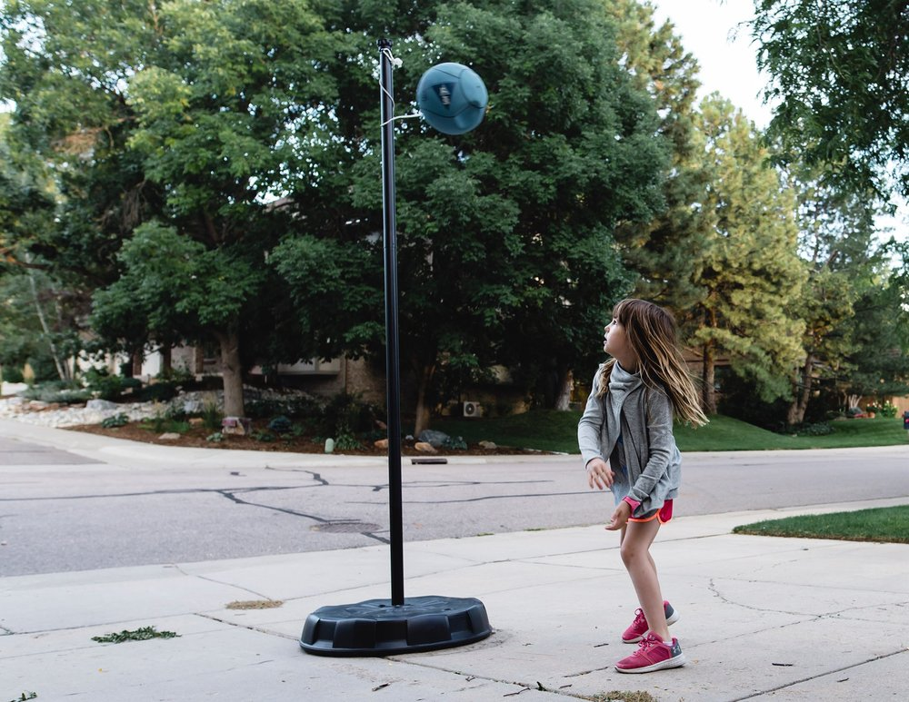 A girl plays tetherball in greenwood village, co.