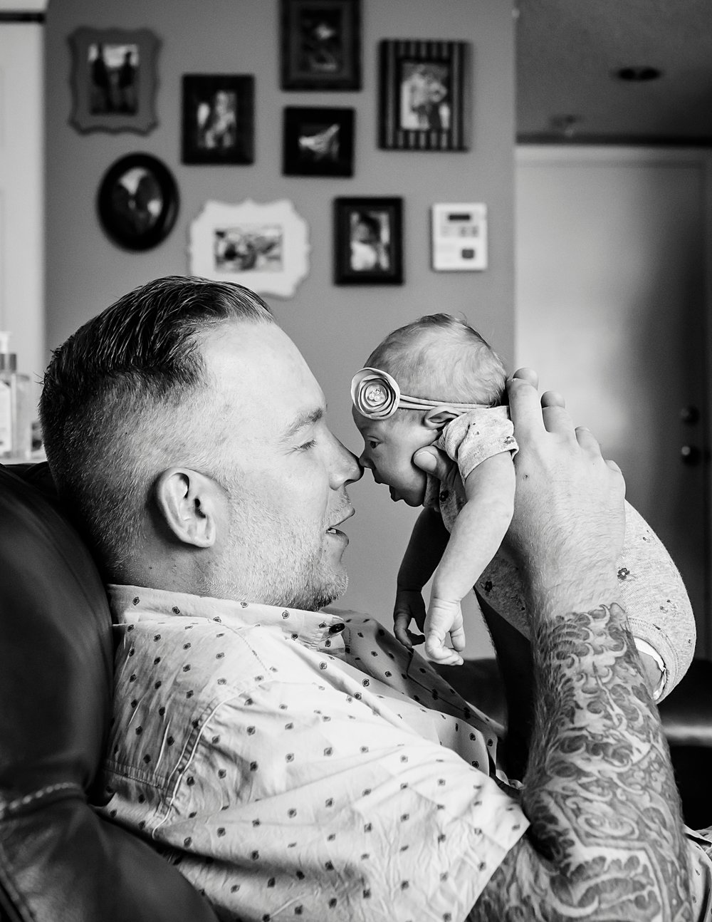 A father snuggles with his newborn baby girl during a Highlands Ranch Photo shoot in south Denver, Colorado, with Kristiina Craven Photography.