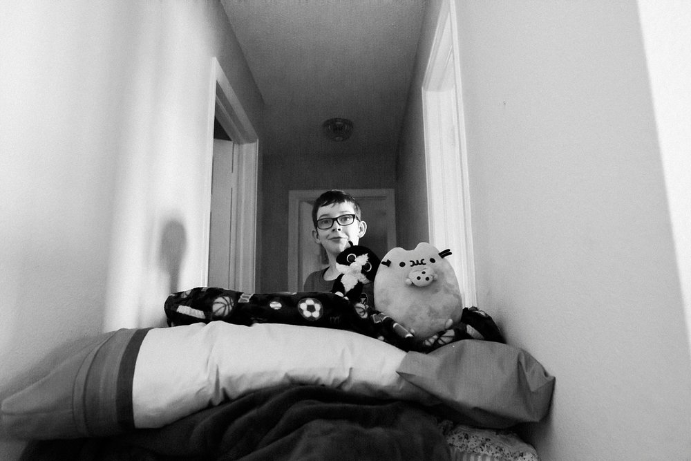 "A boy sets up his fort before battling his sister to a sock war during the ""deschooling"" phase of homeschooling in Colorado."