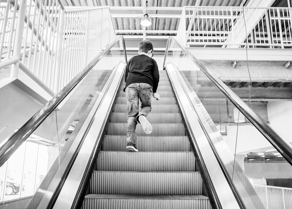 A boy runs up the escalator in IKEA Centennial.  One of the perks of homeschooling is running errands while everyone else is at work or in school!