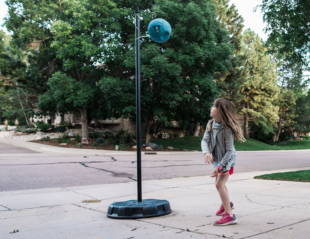 "A girl plays tetherball by herself during the time between public school and home school, also called, ""deschooling""."