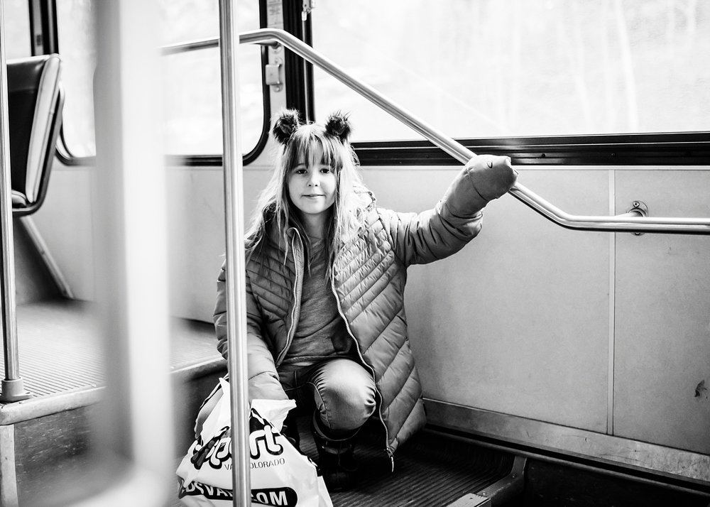 Kate rides the bus while traveling--one of the perks of unschooling the kids: no school schedule to consider! | GettingUnschooled.com