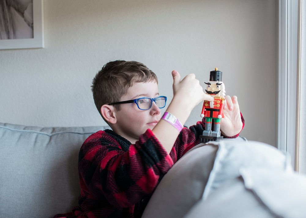 A boy puts his finger in the Lego Nutcracker toy before Christmas! | GettingUnschooled.com