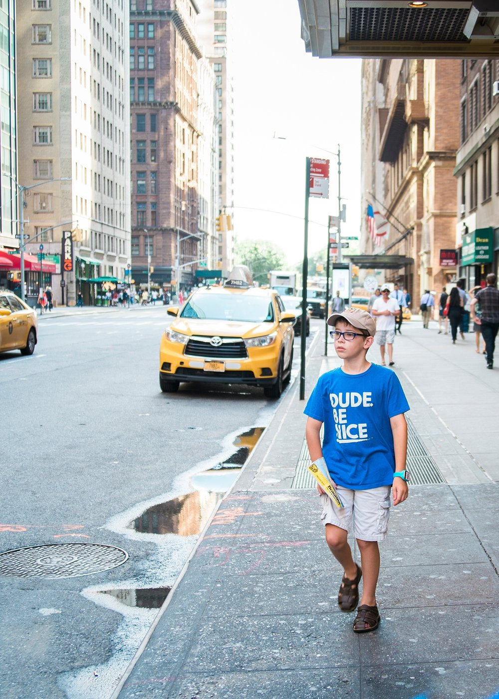 His face perfectly sums up his experience in New York City last summer--it was HOT and HUMID and it was a struggle to motivate the kids out of the cool hotel room!  Tips on traveling with kids of all ages on the blog! | GettingUnschooled.com