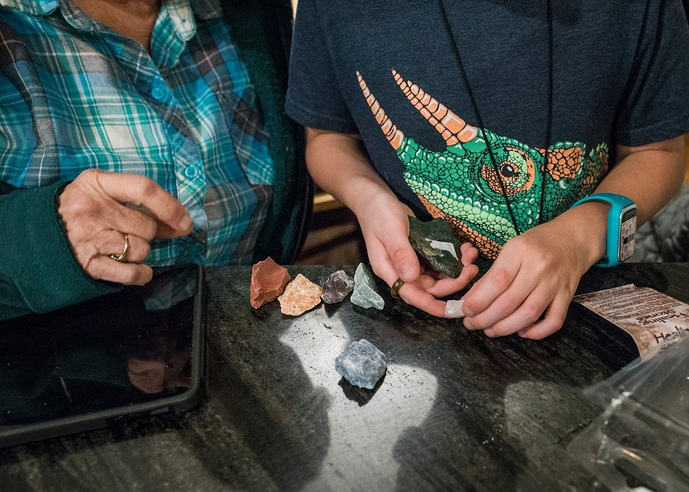 Townes sorts through his gems and rocks with his grandmother after a big haul from New Mexico while roadschooling. | GettingUnschooled.com