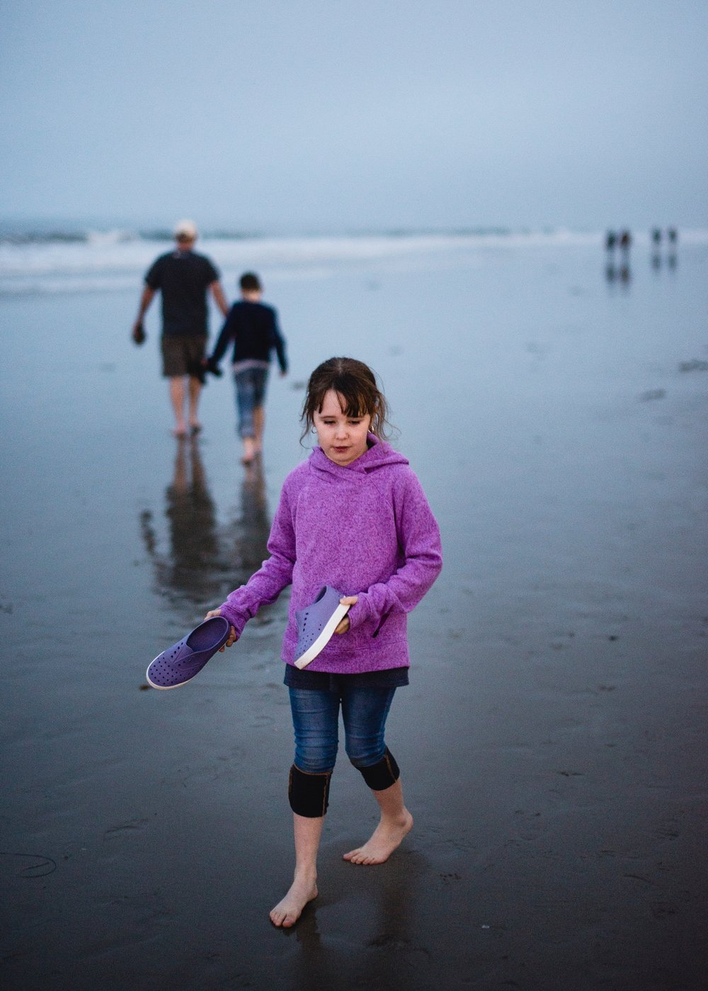 Feeling the sand between her toes at the Santa Monica Pier beach in California during our first roadschooling adventure! | GettingUnschooled.com | #roadschoolers #homeschooltravel #unschool
