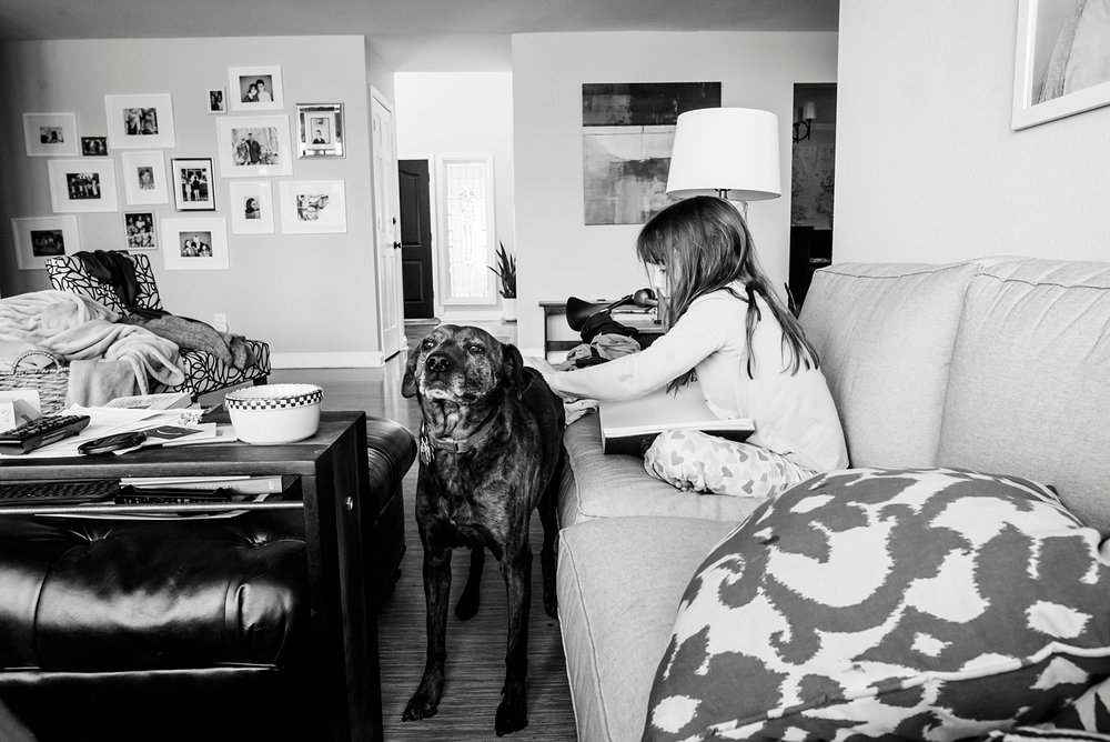 Kate gives Maggie a back scratch during our unschooling morning reading time. | GettingUnschooled.com | #homeschool #unschool #deschool #homeschoolreading