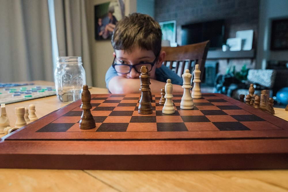 Townes thinks about his next chess move from latest Week in the Life of an Unschooler. | GettingUnschooled.com | #unschool #homeschool #chessclass #deschooling