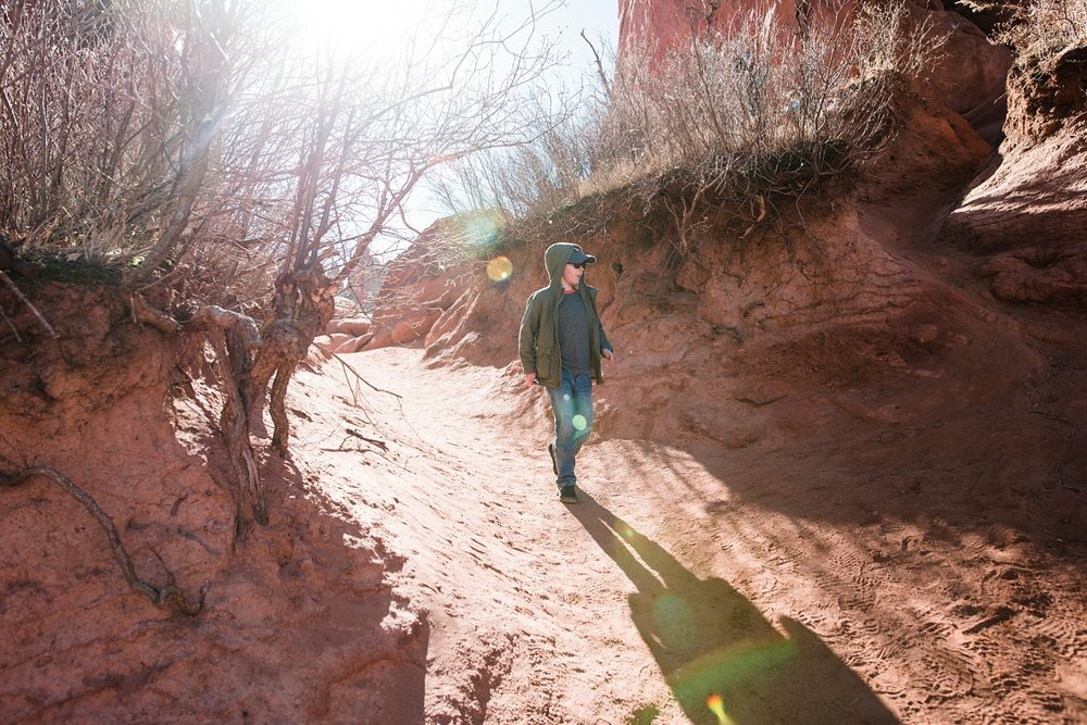 Townes walks on one of the trails at Garden of the Gods in Colorado Springs.  Tips on how to have a great visit to the park are on the blog! | GettingUnschooled.com | #gardenofthegods #coloradodaytrip #denver #unschooling #homeschool #daytrip #traveltips