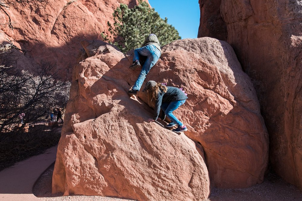 Amateur/beginning rock climbing spots are all over the place at Garden of the Gods in Colorado Springs. Tips on how to have a great visit to the park are on the blog! | GettingUnschooled.com | #gardenofthegods #coloradodaytrip #denver #unschooling #homeschool #daytrip #traveltips