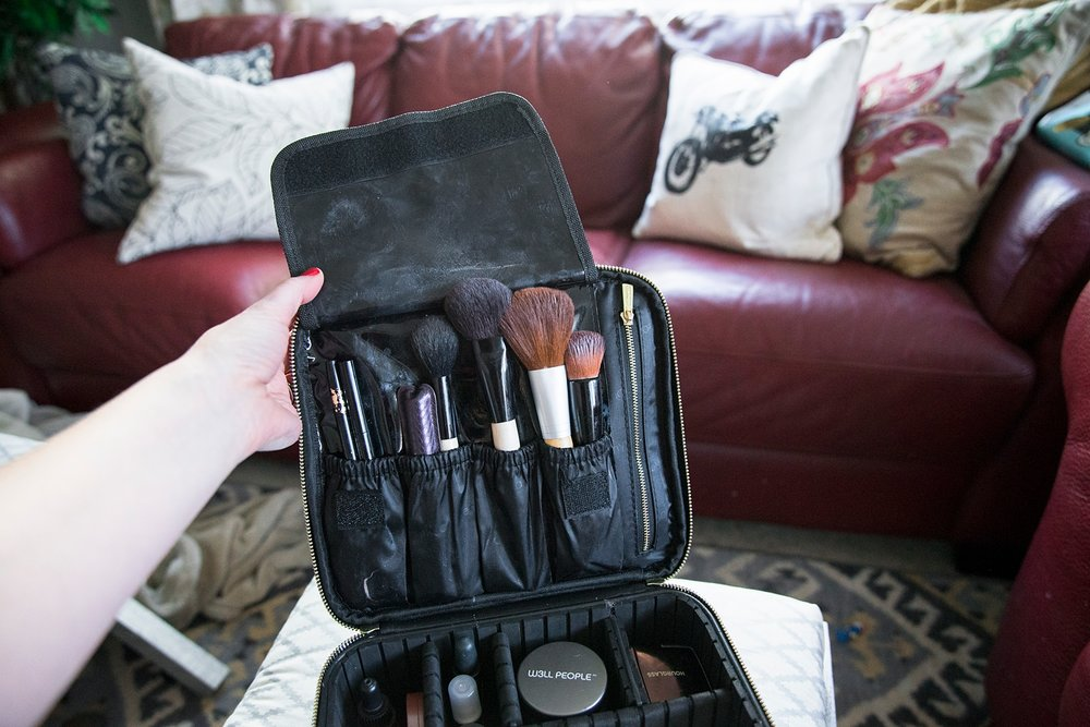 The brush holder on the mini size of the ROWNYEON travel makeup train case keeps brushes sanitary and organized!  This really is the BEST makeup travel bag :)