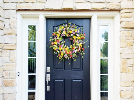 A gorgeous spring wreath is a great first step in decorating your house for spring! See more spring decorating ideas on the blog today!