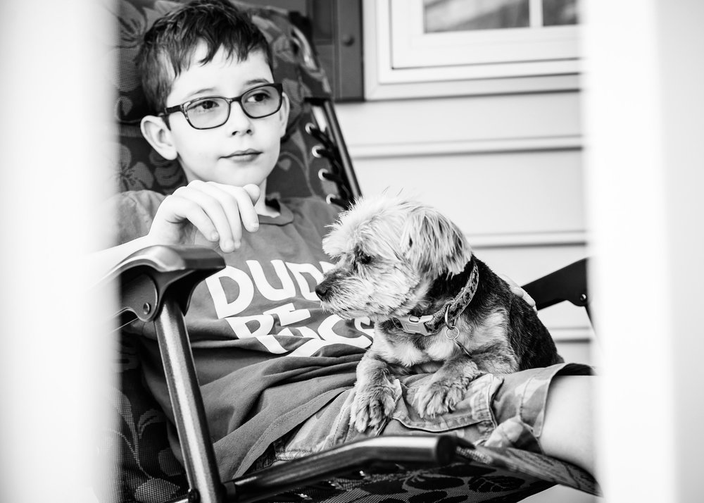 Spending time just sitting and thinking--that's another important part of how to unschool :) Having a dog in your lap also helps!
