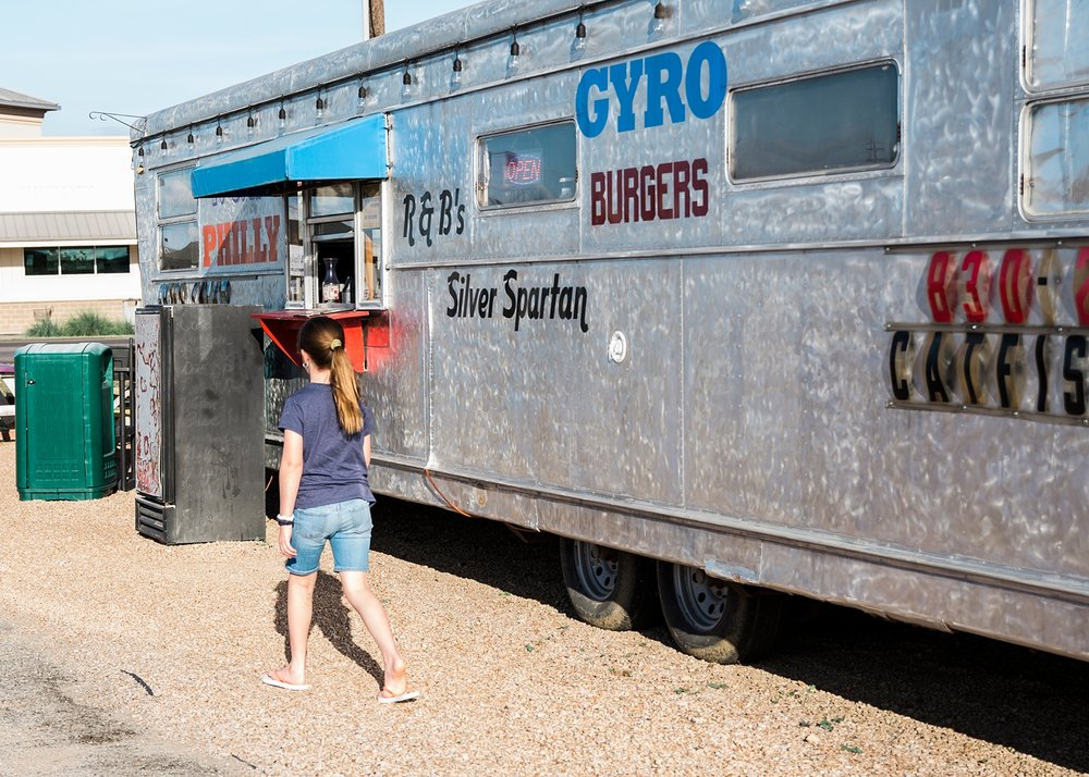 Kate heading to get our order at R&B's Silver Spartan, a popular food truck in Marble Falls, TX.
