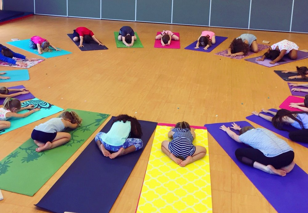 After we move, we stretch.Child's pose -- you could hear a pin drop.