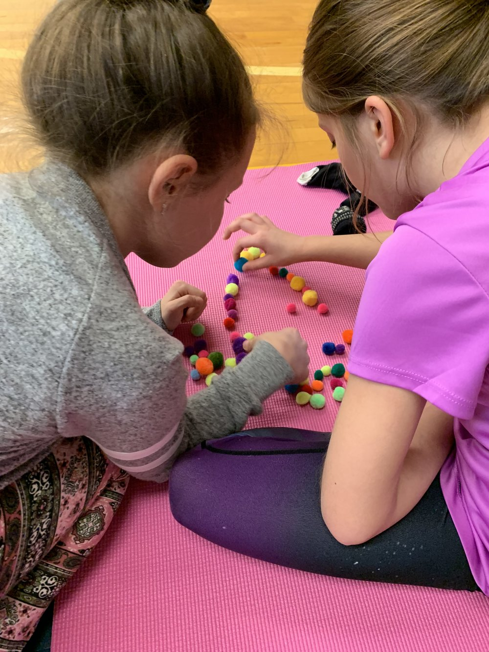 A mindful moment at this Yoga at School program. Partner-work and yoga buds :)