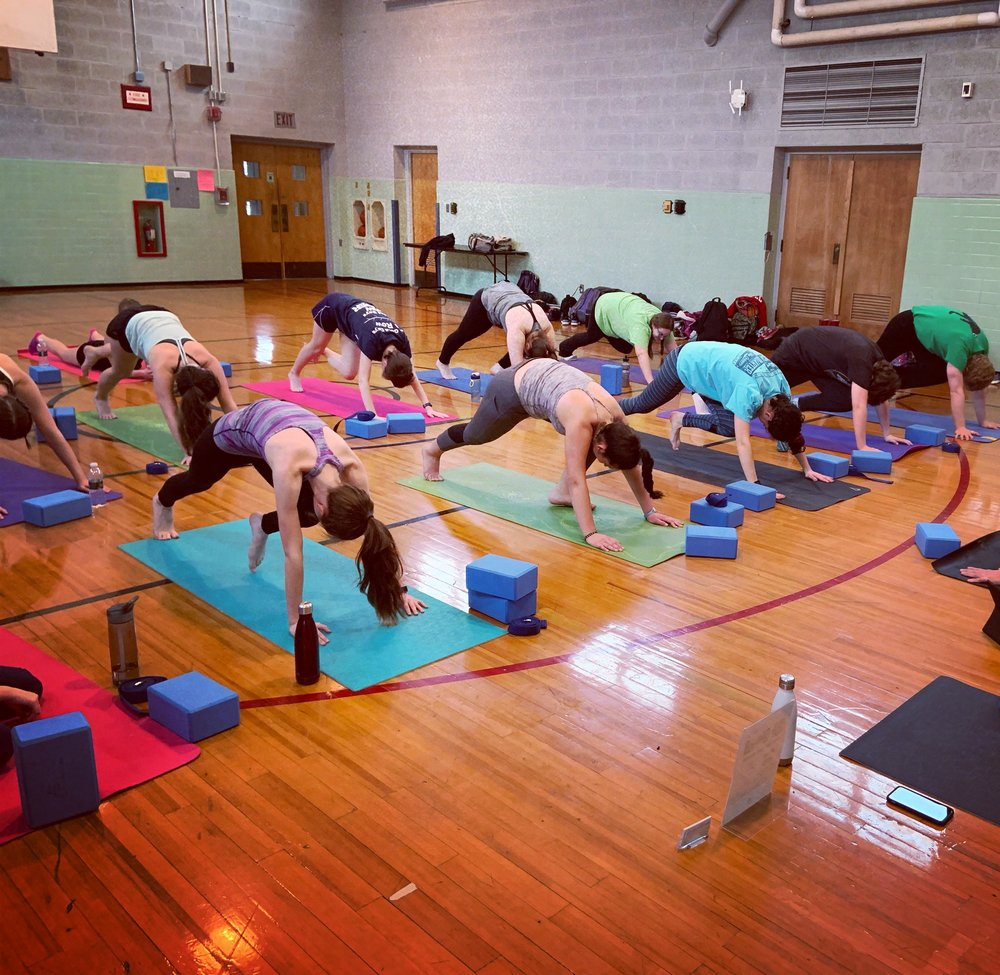Pre-season team yoga session — nice work!