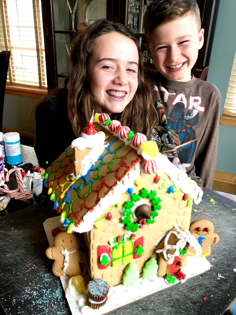 The kiddos with the gingerbread house (from a kit) they decorated together. Love those smiles!