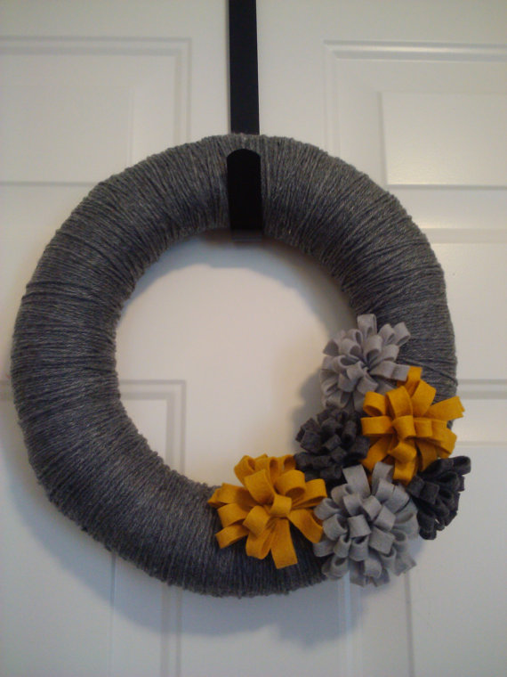 Yellow and grey yarn wreath.