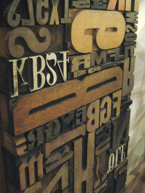 Vintage printing press letters.