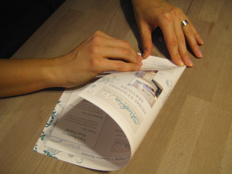 Imgae of me folding the brochures by hand