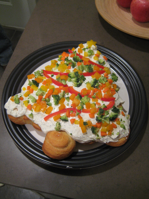 Appetizer displayed in the shape of a Christmas tree.