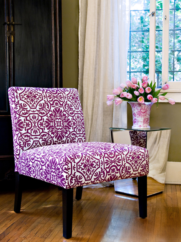 Club chair in orchid pattern.
