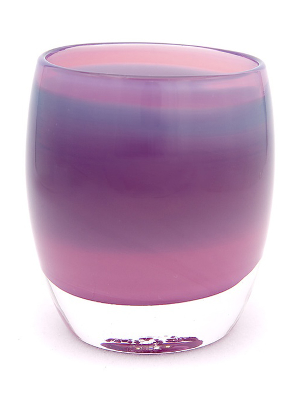 Glass candle in ombre orchid colors.
