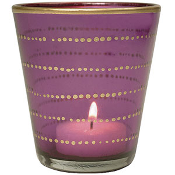 Votive candle in orchid color.